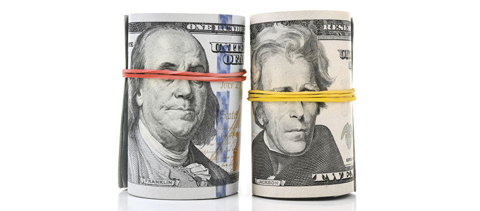 Two rolls of cash with rubber bands strategically placed to cover the eyes of the presidents, suggesting that the government is blind to the simple solution that bundled payments will provide transparency for our healthcare system.